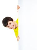 Caucasian boy looking from behind white board Stock Photography