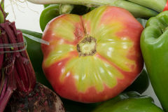 Close-up of a beautiful Coeur de Boeuf tomato stock photos