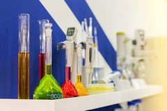 Close up of beautiful colorful chemistry liquid in various laboratory flask on shelves for science royalty free stock photo