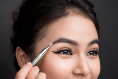 Close up of beautiful face of young asian woman getting make-up. Stock Photos