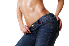 Close-up of beautiful female body in jeans Stock Images