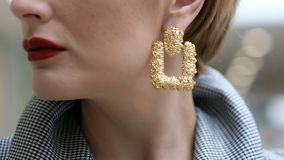 Close up of beautiful female earrings, while a woman turning her head. Close up of female earrings, while a woman turning her head stock video
