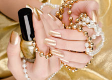 Gold manicure Stock Photo