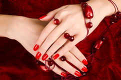 Close up on beautiful female hands with sexy red manicure. Royalty Free Stock Photography
