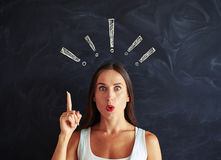 Close-up of beautiful female trying to pay attention against blackboard royalty free stock photos