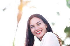 Close up of beautiful friendly woman smiling outside Stock Photo