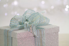 Close up of beautiful gift box in shiny material. Bokeh background Stock Image