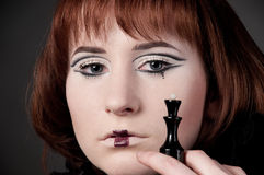 Close-up of beautiful girl with chess makeup Stock Photos