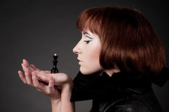Close-up of beautiful girl with chess makeup Stock Image