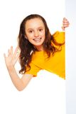 Happy girl and advertising boardd Stock Image