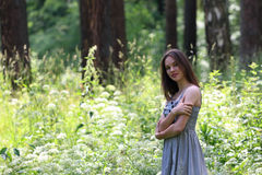 Close-up of beautiful girl in dress with view of forest Royalty Free Stock Photo