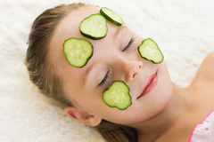 Close up of beautiful girl with facial mask of cucumber Royalty Free Stock Photography