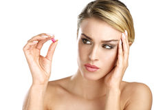 Close up of a beautiful girl having a pill for headache Royalty Free Stock Image