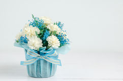 Close up of beautiful Jasmine flower bouquet. With blue ribbon bow on white wooden background - Jasmine is the symbol of Mother& x27;s Day in Thailand stock photography