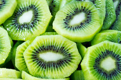 Close up of beautiful kiwi fruit slices background Stock Photography