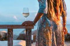 Close up of beautiful l fashion model in elegant dress at sunset with glass of wine. Close up of beautiful l fashion model in elegant dress with glass of wine stock image