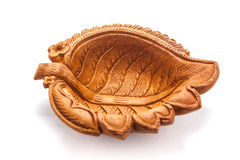 Close up of a beautiful leaf designe clay lamp. Royalty Free Stock Image