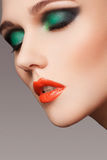 Close-up beautiful model face with fashion make-up Stock Images