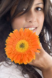 Close up of beautiful model with orange gerbera Royalty Free Stock Photography