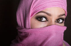 Close-up beautiful mysterious eyes eastern woman wearing a hijab.  Stock Photo