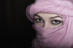 Close-up beautiful mysterious eyes eastern woman wearing a hijab Stock Photo