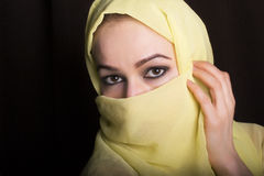 Close-up beautiful mysterious eyes eastern woman wearing a hijab Stock Photography