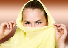 Close-up beautiful mysterious eyes eastern woman wearing a yellow hijab Stock Image