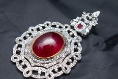 Silver handmade pendant with giant ruby Stock Photography