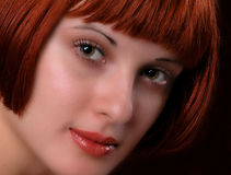 Close-up of beautiful redhead woman with fashion hairstyle Royalty Free Stock Image
