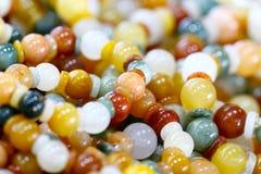 Close up beautiful semiprecious stone beads. Background Royalty Free Stock Photography
