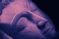 Close up beautiful sleeping Buddha face. Royalty Free Stock Photo