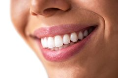 Close up of a beautiful smile with shining white teeth royalty free stock photos