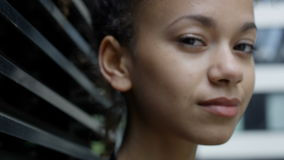 Close up of beautiful smiling African American woman in urban background. stock footage
