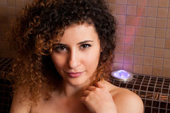 Close-up of beautiful smiling woman relaxing in wet sauna room Stock Images