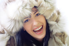 Close-up of beautiful smiling woman wearing fur. Close-up portrait of a beautiful smiling young woman wearing fur Royalty Free Stock Images