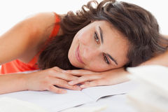 Close-up of a beautiful student head on her homeworks Stock Images