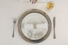 Beautiful table setting for an occasion. Close-up of beautiful table setting for an occasion Stock Image