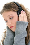 Close Up of Beautiful Teen Girl Listening To Headphones Royalty Free Stock Photo