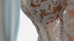 Close-up of the beautiful vintage wedding dress stock video