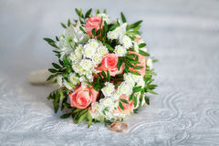 Close up of beautiful wedding bouquet with golden rings Stock Photography