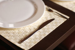 Close-up with a beautiful white plate and a knife Royalty Free Stock Image