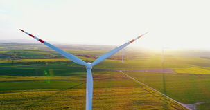 Close up of beautiful windmill turbines, wind reneval energy turbines. Windmill and Wind power technology background. Aerial view on Wind Power, Turbine stock video footage