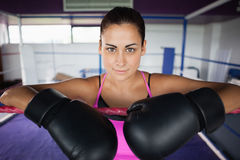 Close up of a beautiful woman in black boxing gloves Stock Image
