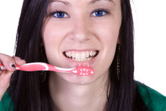 Close up of a beautiful woman brushing her teeth Stock Photos