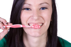 Close up of a beautiful woman brushing her teeth Stock Photography