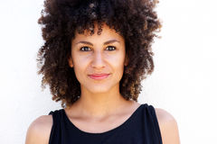 Close up beautiful woman with curly hair standing by white background Royalty Free Stock Photos