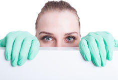 Close-up of beautiful woman doctor eyes standing behind banner Royalty Free Stock Photo