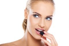 Close up of beautiful woman eating blackberries Stock Images
