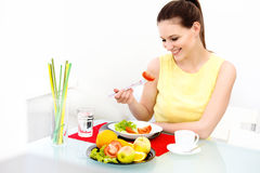 Close-up Of Beautiful Woman Eating healthy food Royalty Free Stock Images