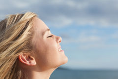 Close up of beautiful woman with eyes closed against sky Stock Photo